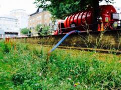 A tanker of water is pumped into a swale in Hammersmith. Image: Groundwork